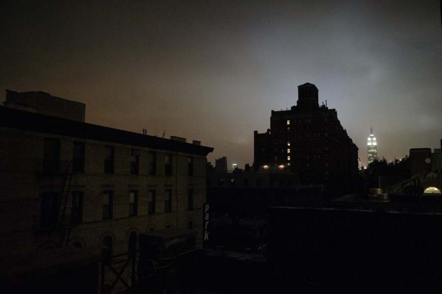 Widespread power outages have turned the city dark