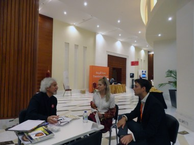 Eric Greene and Bernadetta Deron discuss publishing and philanthropy with Michel Moushabeck (left).