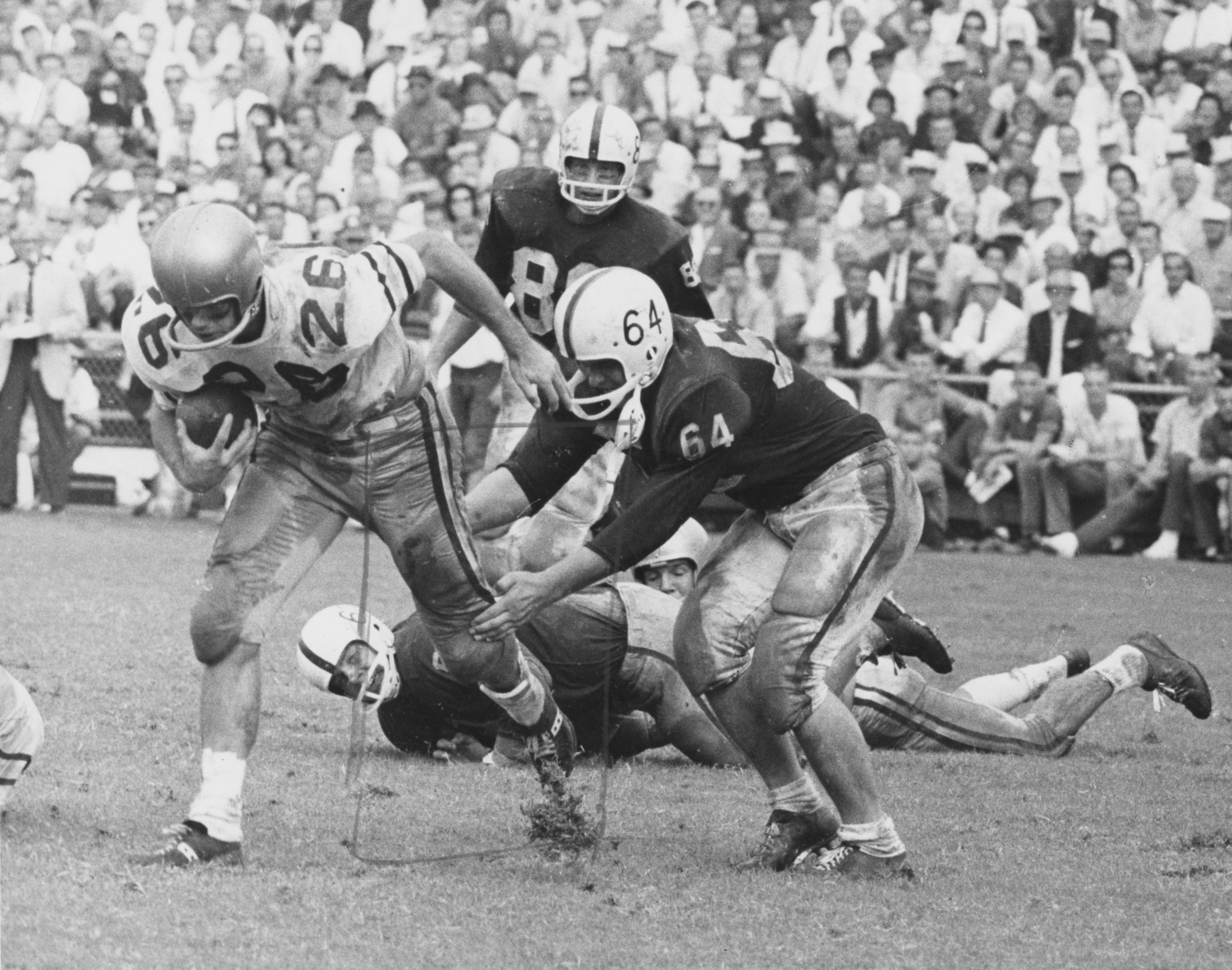 Unidentified Football Players During Game Against Unidentified Opponent Photographer Bill