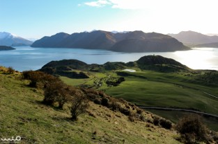 """Looking down at Lake Wanaka, with what William dubbed """"One Tree Hill"""" off to the right. A little stream leads through the sheep pasture."""