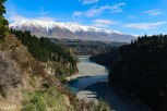 The Rakaia Gorge splits the Canterbury region in two. There is a wide, blue river that winds from the white snow-capped mountains.