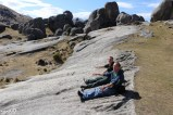 """Philip and William """"sliding"""" down a sloping part of Castle Hill limestone"""