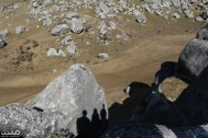 Our three shadows on a limestone boulder, Castle Hill, NZ