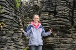 Jessica sandwiched between the pancake rocks