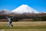 Jessica jumps for joy with Mt Ngauruhoe as the backdrop