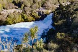 Huka Falls is a powerful waterfall that drains out of Lake Taupo and into the Waikato River. The Waikato River leads all the way to Auckland. It's not so much a vertical waterfall as a lateral waterfall.