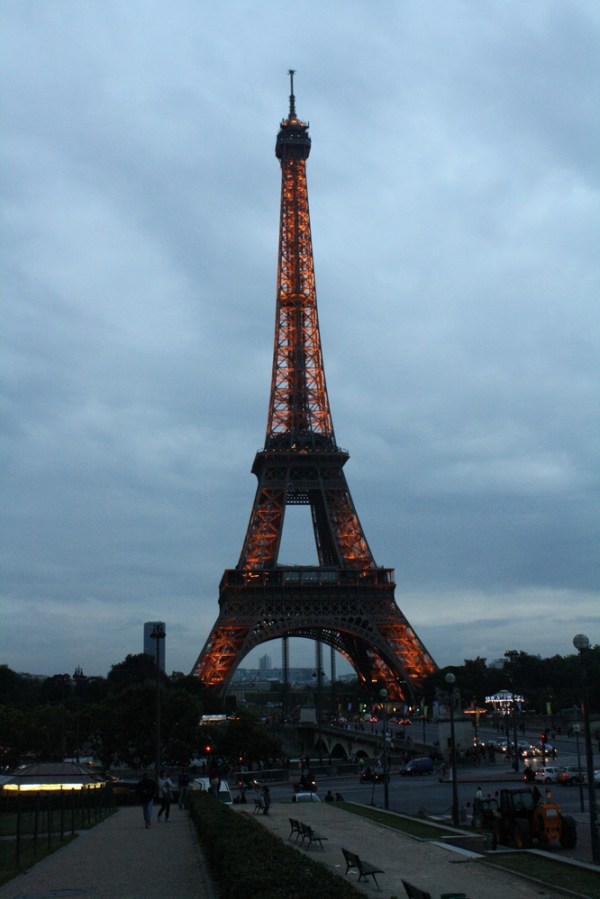 Eiffel tower glowing and lit up in evening
