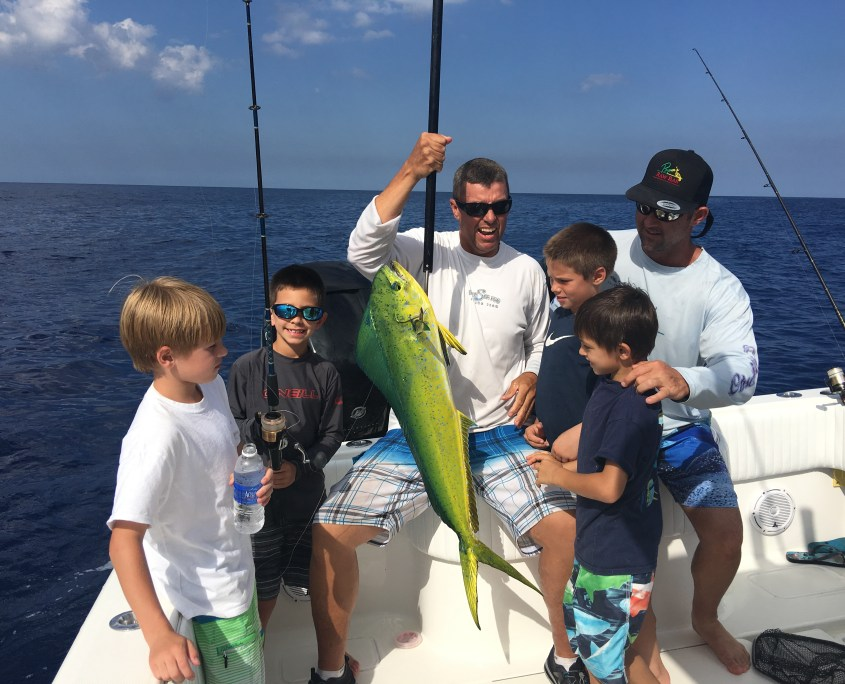 kids fishing for mahi