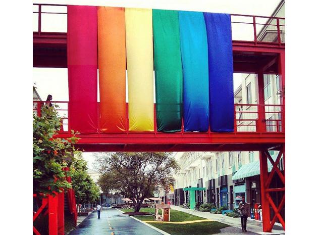 Rainbow flags above a city street
