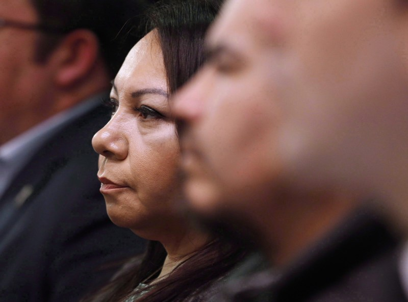 Sheila North Wilson, grand chief of Manitoba Keewatinowi Okimakanak, listens to an RCMP announcement at a press conference in Winnipeg in 2016.