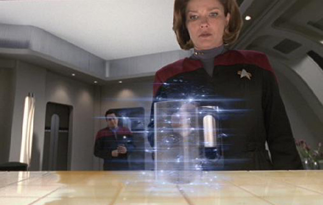 Captain Janeway waits impatiently for a replicator to finish