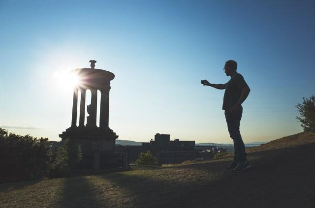 Person taking a photo at Calton Hill, Edinburgh