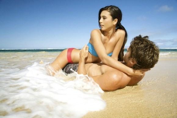 weirdest places someone got their penis stuck, couple on beach, penis captivus