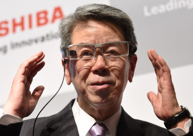 Toshiba CEO Hisao Tanaka using smart glasses