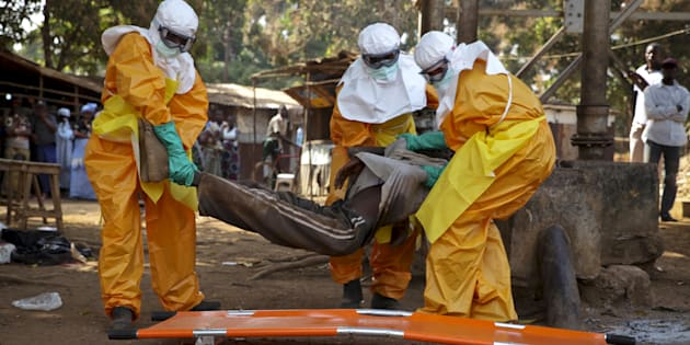 A French Red Cross team picks up a suspected Ebola case from the centre of Forecariah, Guinea on Jan. 30, 2015.