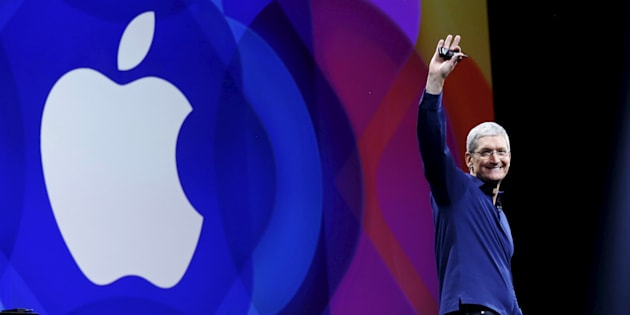 Apple CEO Tim Cook waves as he arrives on stage to deliver his keynote address at the Worldwide Developers Conference in San Francisco, Calif., June 8, 2015. Apple revamped its overseas subsidiaries to take advantage of tax loopholes on the European island of Jersey after a crackdown on Ireland's loose rules began in 2013, an investigation has revealed.