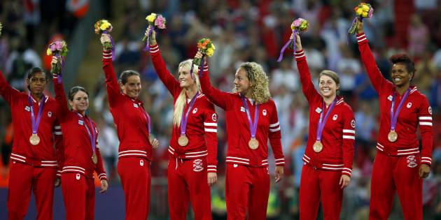 The Canadian team pose with their bronze medals for women's soccer during the victory ceremony at Wembley Stadium during the London 2012 Olympic Games, August 9, 2012. (REUTERS/Brian Snyder)