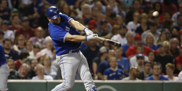 Toronto Blue Jays designated hitter Kendrys Morales (8) hits a two-run home run against the Boston Red Sox during the fifth inning at Fenway Park.