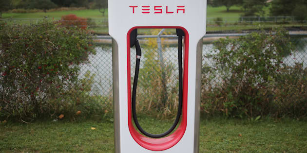 A Tesla electric vehicle charger is seen on a river bank at the edge of a parking lot in Kitchener, Ont., Oct. 13, 2017.