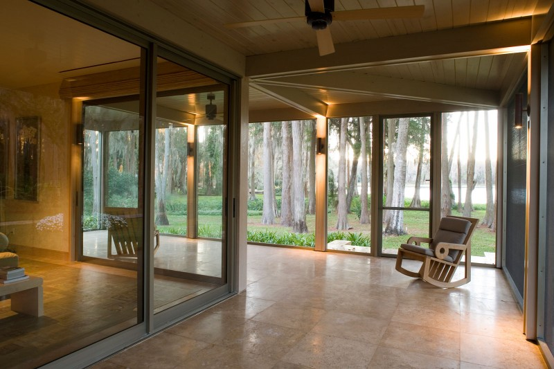 bedroom windows and veranda looking out to trees and lake