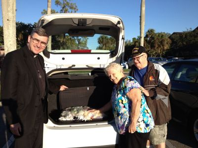 "When I stayed with Fr. John in Florida, we often got calls for ""Rosary Pick Ups."" Here is one! A trunk full of Rosaries!"