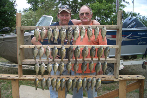 My retired dad and I posing with crappie and bluegill from Lake Marindahl