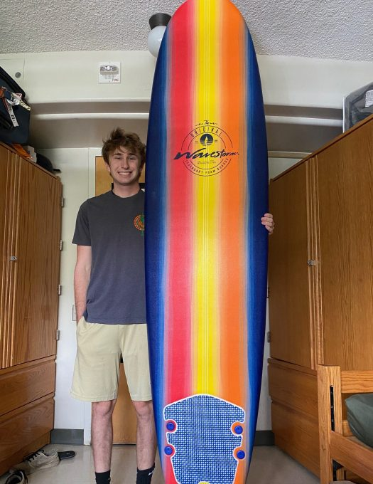 Happy UH Student with Wavestorm Surfboard