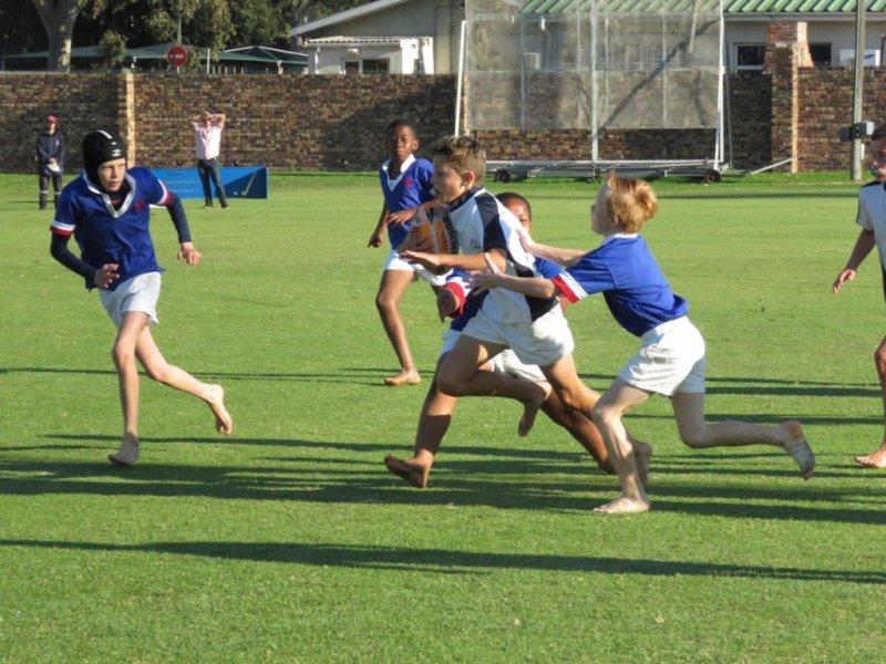 Oakhill U11 Tristan Torance dashing to the try line (Copy)