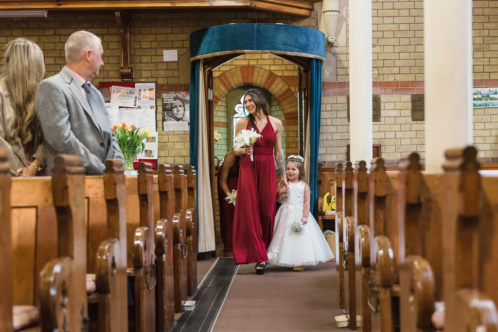 Bridesmaid and flowergirl walking down the aisle | Sidcup Wedding of Becky & Hugo | Oakhouse Photography