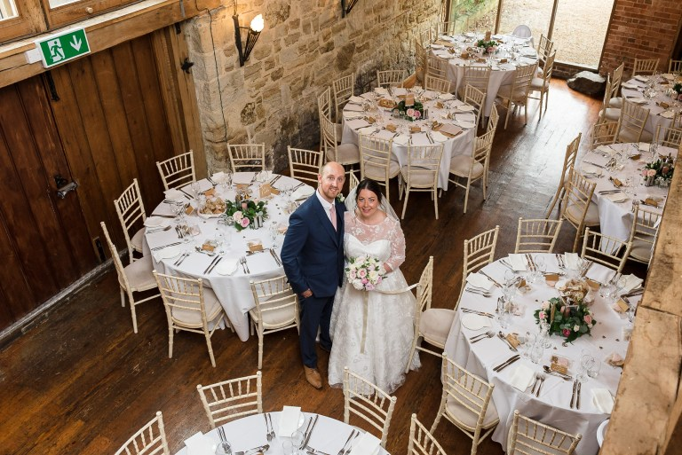 Bride and groom inside Swallows Oast wedding venue, Ticehurst, East Sussex | Oakhouse Photography