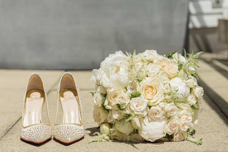 Wedding flowers and wedding shoes photographed on the balcony of the penthouse at the Chelsea Harbour Hotel, Chelsea, London