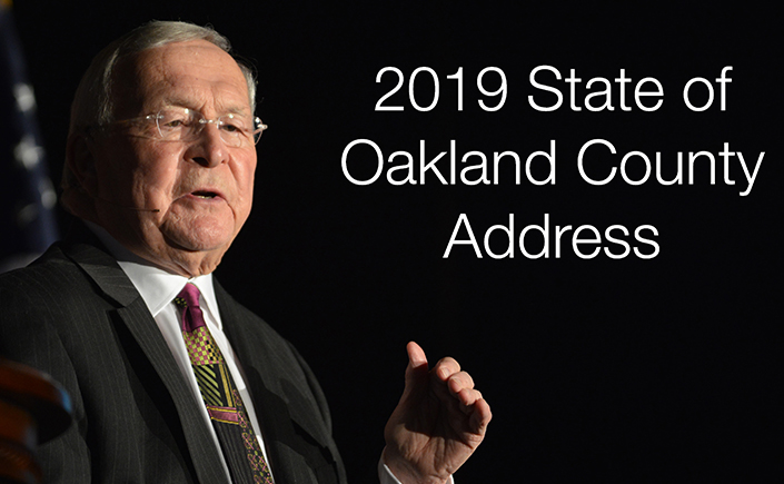 Photo of L. Brooks Patterson with text that says: 2019 State of Oakland County Address