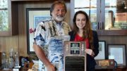 Bob Alvarado of NCCRC Presents Plaque To Maria Ayerdi Kaplan