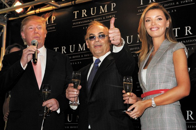 Donald Trump, left, chairman and president of The Trump Organization, Phil Ruffin, entrepreneur/ developer, and Ruffin's wife Oleksandra celebrate with a toast during an official opening ceremony for the Trump International Hotel & Tower Las Vegas in Las Vegas, Nevada Friday, April 11, 2008. The 64-story hotel-condominium project opened March 31, 2008. STEVE MARCUS / LAS VEGAS SUN