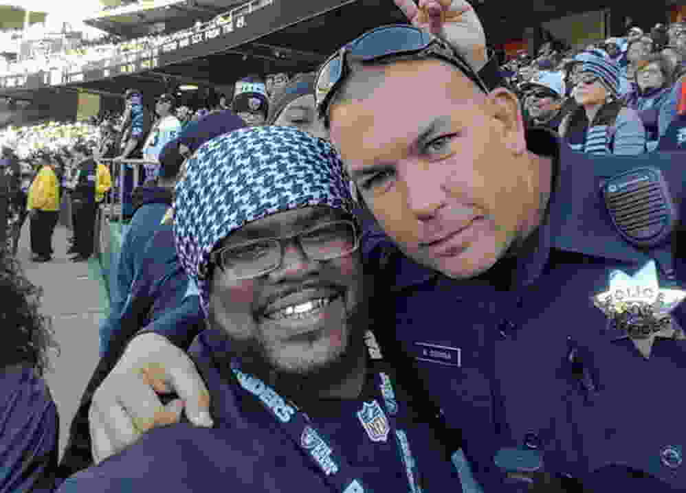 Brandon Dawkins with Oakland Police Officer Mike