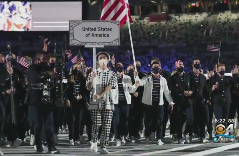 Family Of Miami's Eddy Alvarez Watch Proudly As He Carries American Flag At Olympics Opening Ceremon