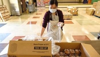woman bagging muffins