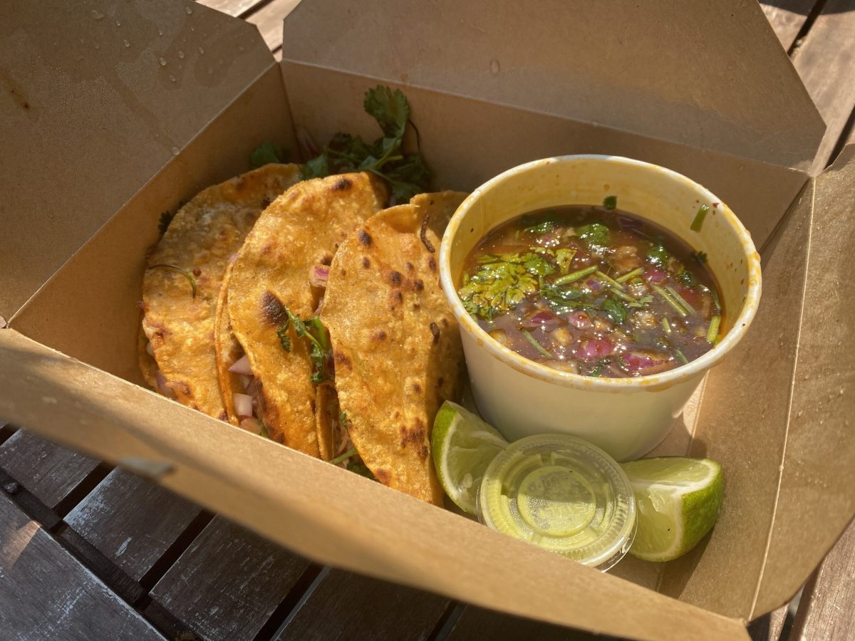 Three birria tacos and a cup of consome from La Santa Torta taco truck in Oakland.