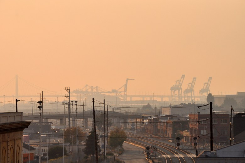 A view of the Port of Oakland through smoky skies