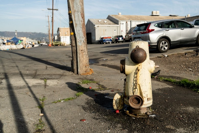 fire hydrant with rusted cap over entry point