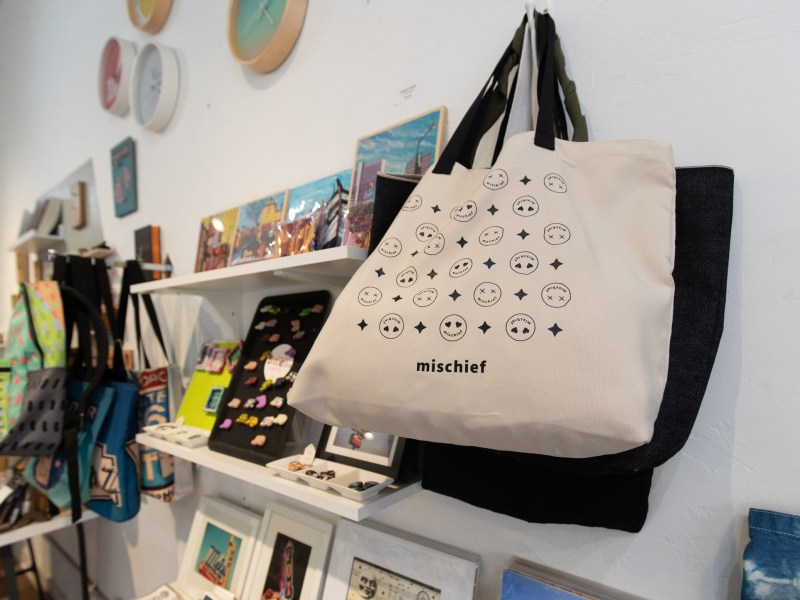 Bags for sale with Mischief Oakland's brand and design on the product