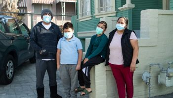 Maria González and her family in front of their home in East Oakland.