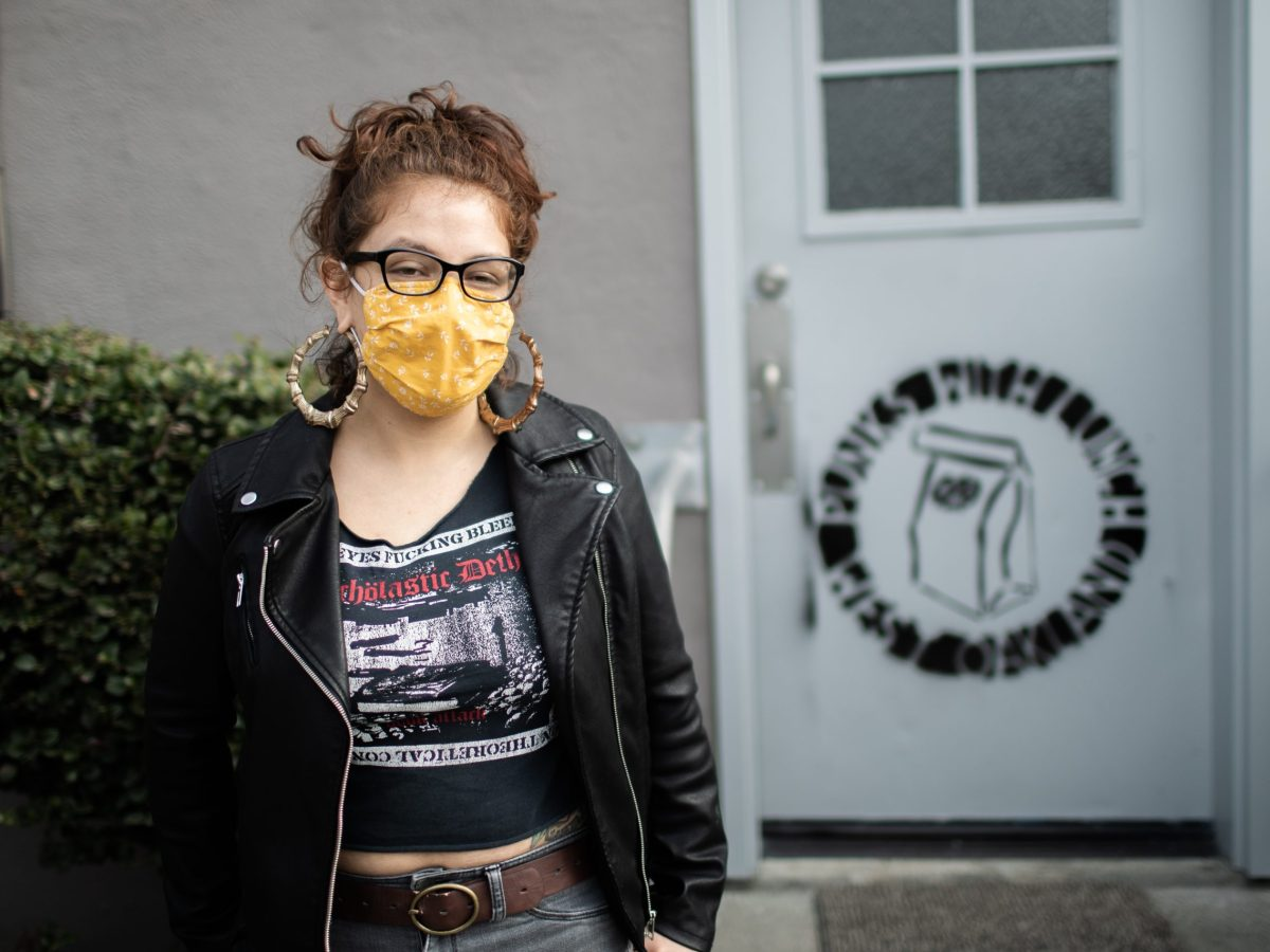 Alejandra Del Pinal, an organizer with Punks with Lunch in front of their HQ