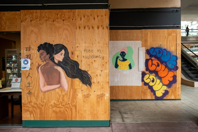 Murals in Oakland's Chinatown depicting Black and Asian American unity.