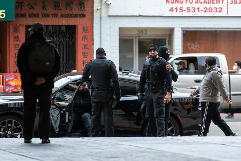 Private security, Goliath Protection Group patrolling the streets of Chinatown after recent incidents of violence.