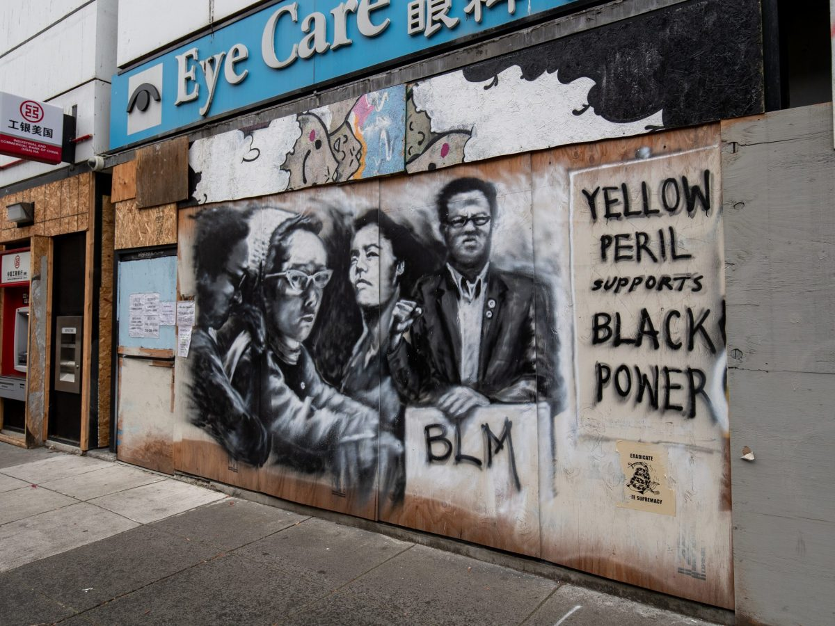 """Yellow Peril Supports Black Power"" mural in Chinatown. One of the many murals in the area supporting Asian and Black American unity."
