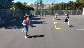 kids running on a court