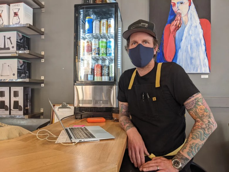 Cortt Dunlap, owner of Awaken Cafe & Roasting on Broadway in downtown Oakland, after opening the doors to the public on Tuesday. He says not much will change for his business until people return to working in their offices downtown.