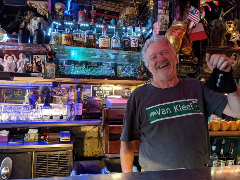 Rick Eggers, day manager at Cafe Van Kleef, gets the bar ready to welcome back patrons at full capacity after state officials lifted restrictions as of Tuesday, June 15.