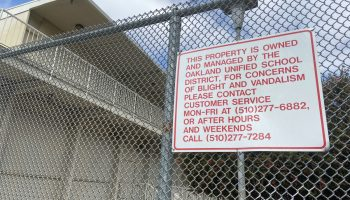 sign on a fence